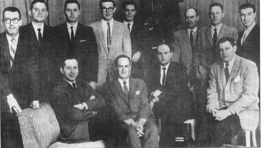 Jack   Ogilvie, Lou Douglas, Van Miller, Ken Phillips, Gene Kelley, Virgil   Booth, Carl erikson, Bernie Sandler. Seated: Steve Geer, Harry Webb,   Bill Ferguson, Mike Mearian.